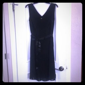 Black pleated cocktail dress with belt